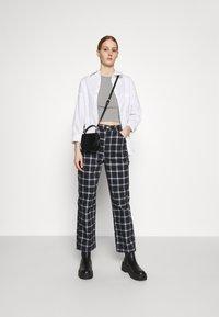 Monki - MEJA FANCY SHIRT - Button-down blouse - white solid - 1