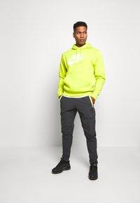Nike Sportswear - FESTIVAL - Tracksuit bottoms - smoke grey/volt - 1