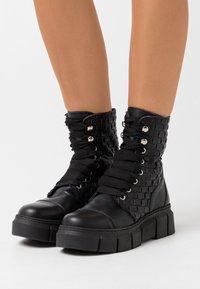 ALOHAS - CAN  - Platform ankle boots - black - 0
