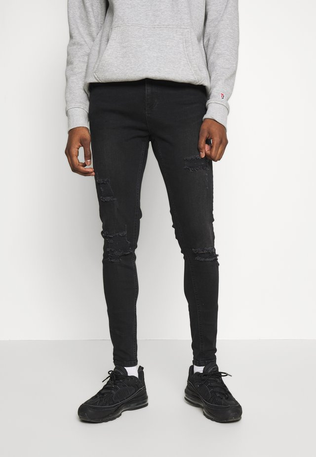 ESSENTIAL DISTRESSED - Vaqueros pitillo - washed black