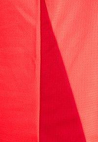 Puma - RUN FAVORITE TANK  - Sports shirt - sunblaze/persian red - 2