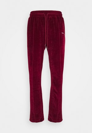 TRACK PANTS UNISEX - Teplákové kalhoty - darkred