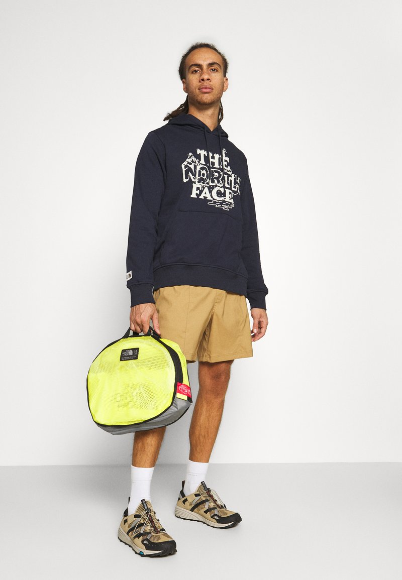The North Face - BASE CAMP DUFFEL M UNISEX - Sports bag - light yellow