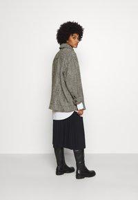 Weekday - CARLI JACKET - Short coat - black/white - 2