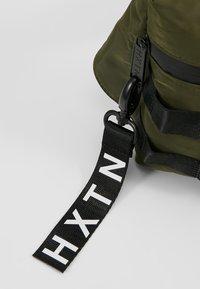 HXTN Supply - UTILITY TAPER CROSSBODY - Bum bag - olive - 7