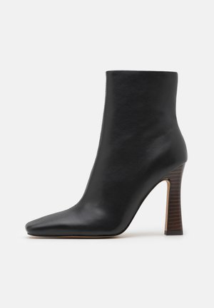 FLARED BOOTS - High heeled ankle boots - black