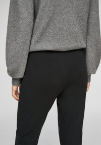 s.Oliver - Tracksuit bottoms - black - 4