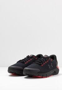 Under Armour - CHARGED  - Zapatillas de running neutras - black/versa red - 2