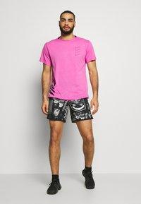 Nike Performance - WILD RUN - Sports shorts - black - 1