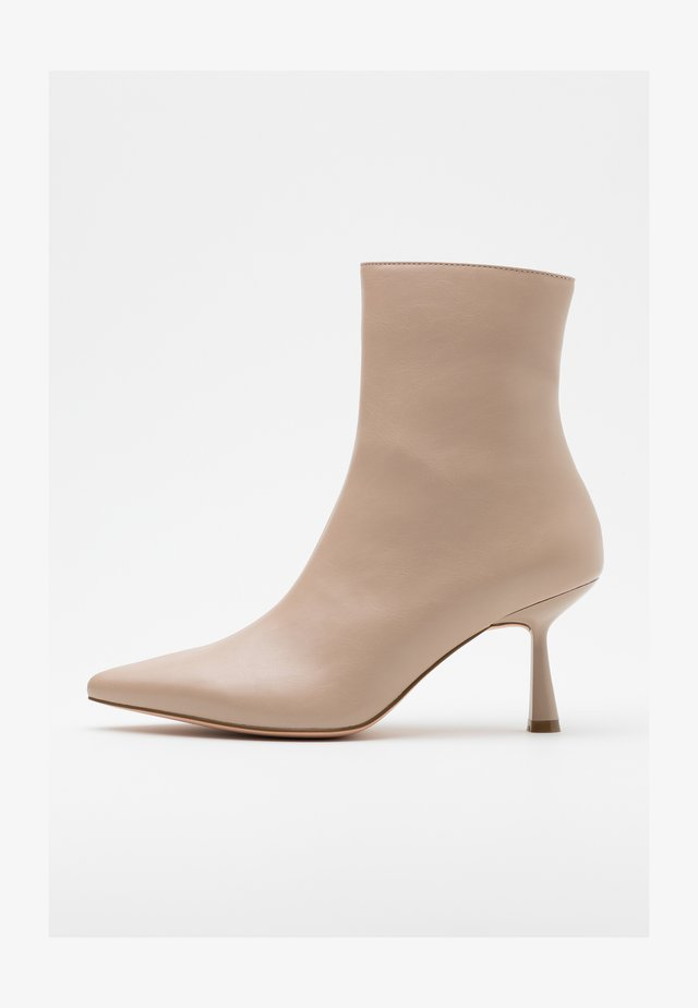 FRONT SEAM BOOTS - Classic ankle boots - beige