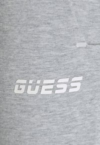 Guess - LONG PANTS - Tracksuit bottoms - light heather grey - 5