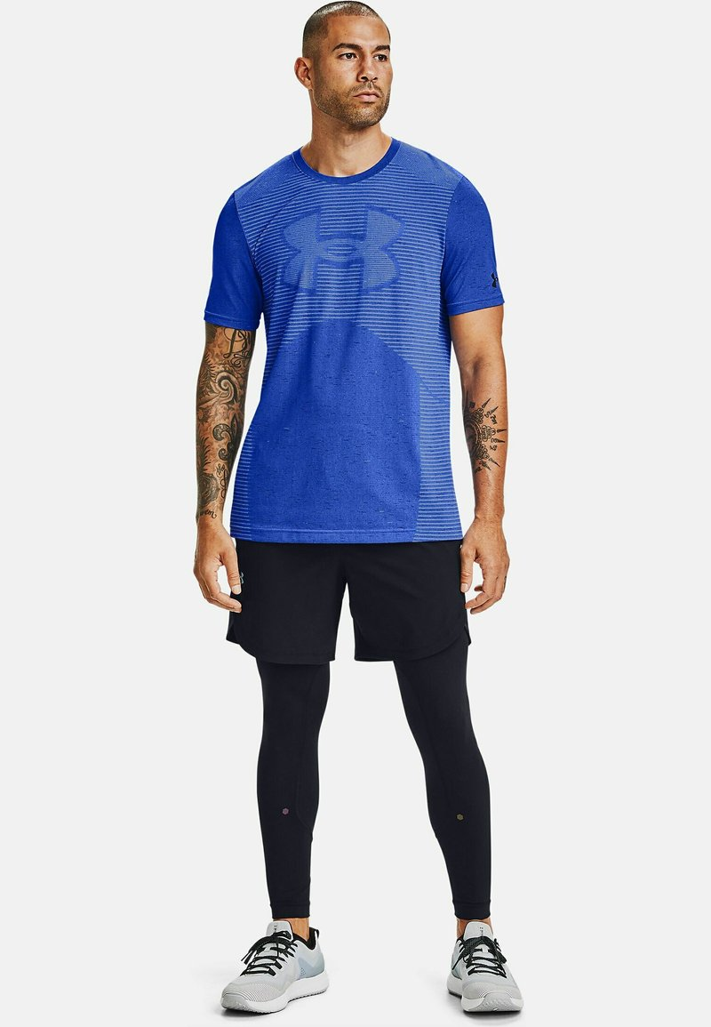 Under Armour - UA SEAMLESS LOGO SS - Sports shirt - emotion blue