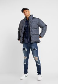 Topman - STRIPE PUFFER - Winter jacket - black - 1