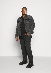 Calvin Klein - LIQUID TOUCH LONG SLEEVE - Polo shirt - black - 1