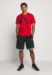 Nike Performance - TEE - T-shirt con stampa - university red - 1