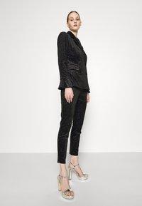 Never Fully Dressed - GLITTER DYNASTY TROUSER - Kalhoty - black - 3