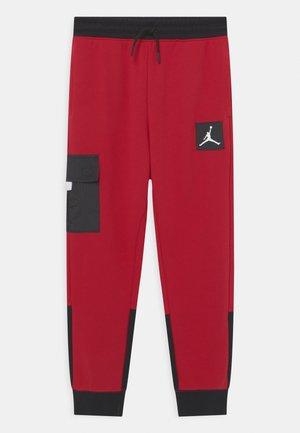 NEXT UTILITY - Teplákové kalhoty - gym red
