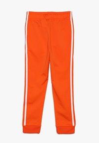 adidas Originals - SUPERSTAR PANTS - Teplákové kalhoty - orange/white - 1