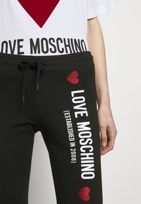 Love Moschino - Spodnie treningowe - black - 5