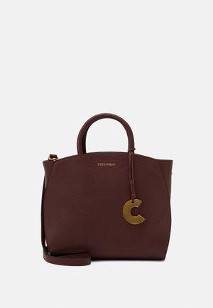 CONCRETE - Handbag - marsala
