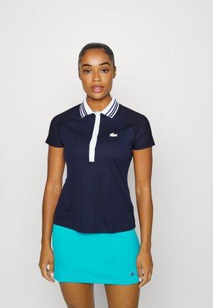 TENNIS - Polo shirt - bleu marine/blanc