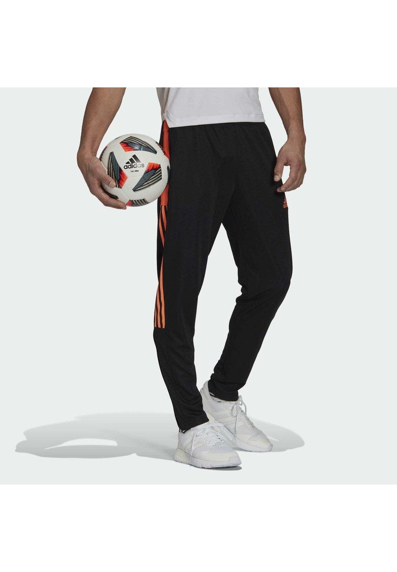 adidas Performance - TIRO  - Træningsbukser - black/scrora