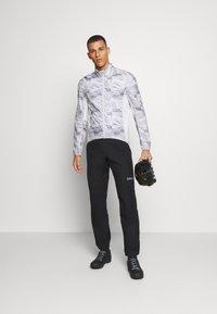 Gore Wear - GORE® C3 GORE-TEX PACLITE® - Trousers - black - 1