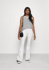 Dr.Denim - MACY - Flared jeans - off white - 1