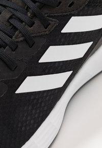 adidas Performance - DURAMO - Neutrala löparskor - core black - 5