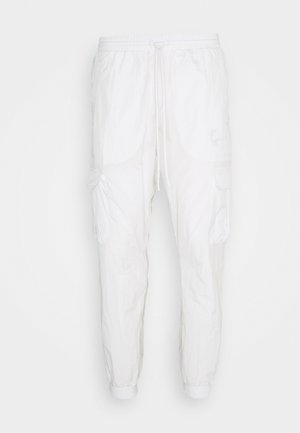 SIGNATURE TRACKPANTS UNISEX - Tracksuit bottoms - off white