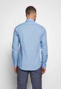 Calvin Klein Tailored - STRETCH - Formal shirt - light blue - 2