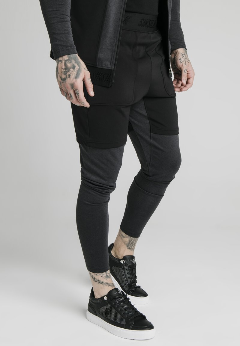SIKSILK - Trainingsbroek - black