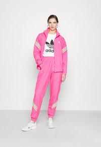 adidas Originals - SWAROVSKI TRACK PANT - Träningsbyxor - solar pink - 1