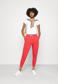 Polo Ralph Lauren - SEASONAL - Tracksuit bottoms - spring red - 1