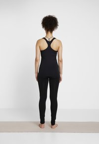 Curare Yogawear - TANK - Débardeur - black - 2