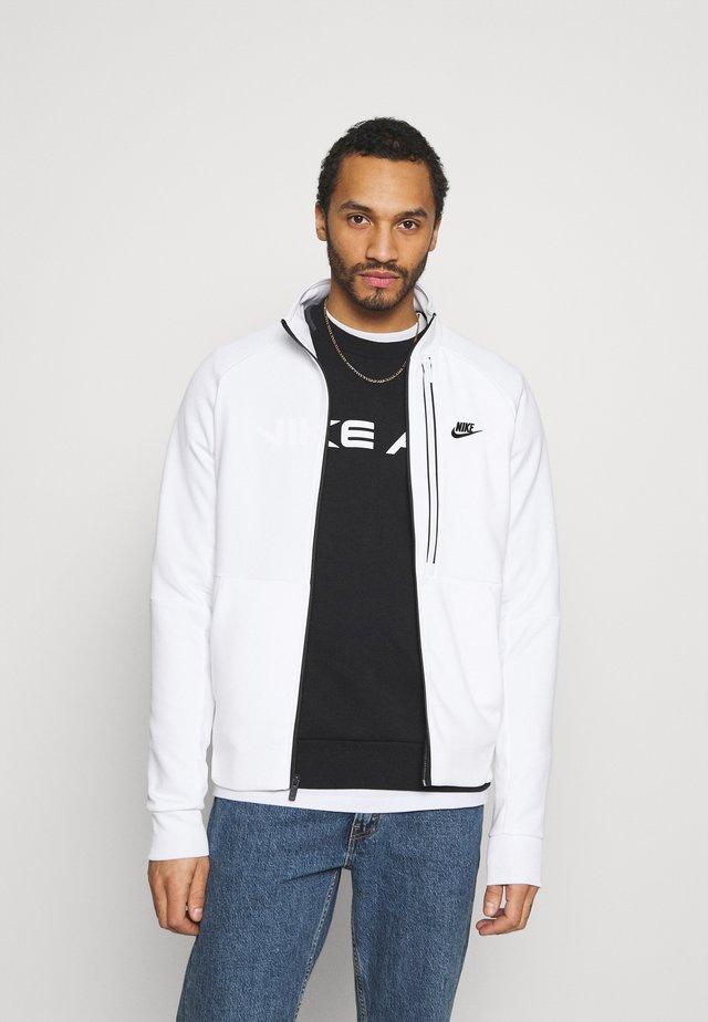 TRIBUTE - Training jacket - white/black