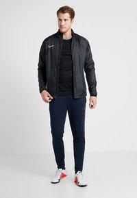 Nike Performance - FC BARCELONA PANT - Tracksuit bottoms - obsidian/rush blue - 1