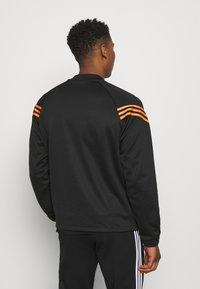 adidas Originals - SWAROVSKI TRACK UNISEX - Sportovní bunda - black/trace orange - 2