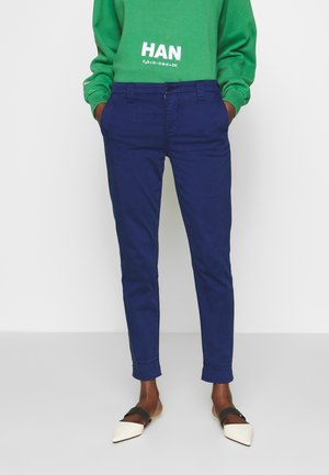 PAZ SLIM TAPER MID RISE - Trousers - indigo gloss