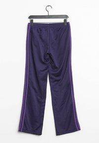 adidas Performance - Tracksuit bottoms - purple - 1