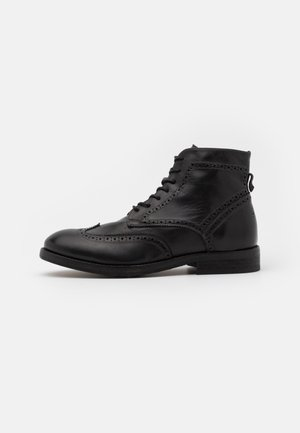 ANDERSON - Lace-up ankle boots - black