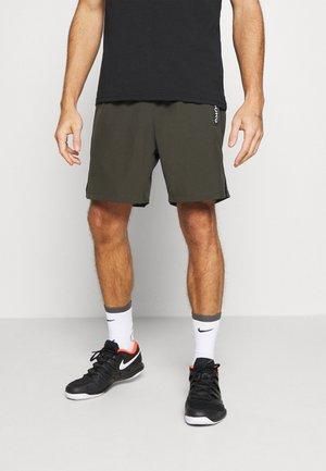 ADILS - Sports shorts - rosin