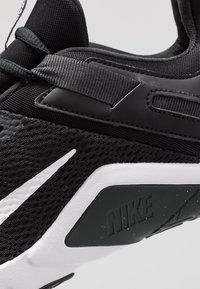 Nike Performance - LEGEND ESSENTIAL - Sports shoes - black/white/dark smoke grey - 5