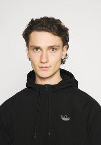 adidas Originals - Summer jacket - black - 3