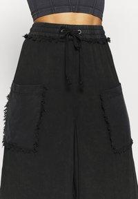 Free People - SURE THING PANT - Pantalones deportivos - black - 3