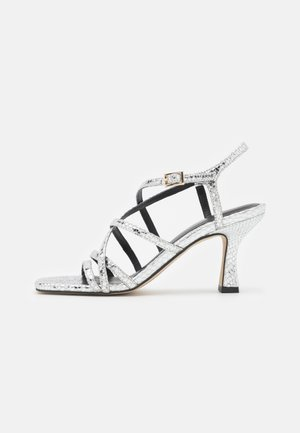 Sandales - metal papua argento