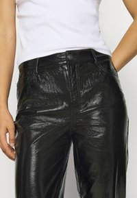 ONLY - ONLEMILY VENYL PANT - Trousers - black - 4