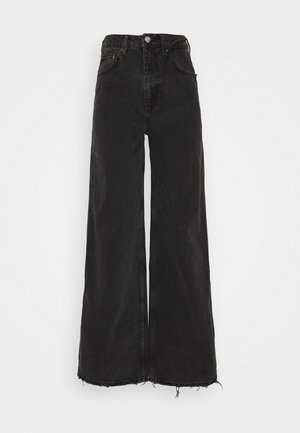 PUDDLE  - Flared jeans - washed black
