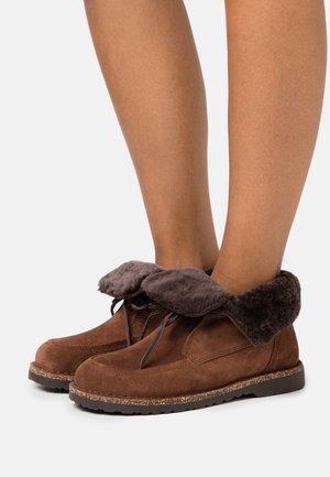 BAKKI - Ankle boots - espresso