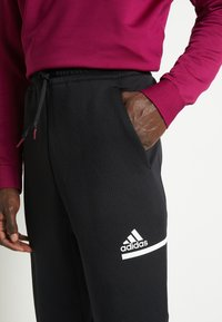adidas Performance - SPORTSWEAR AEROREADY PANTS - Teplákové kalhoty - black - 6
